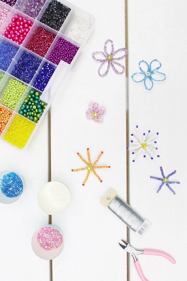 Bead kit and completed beaded flowers and tools
