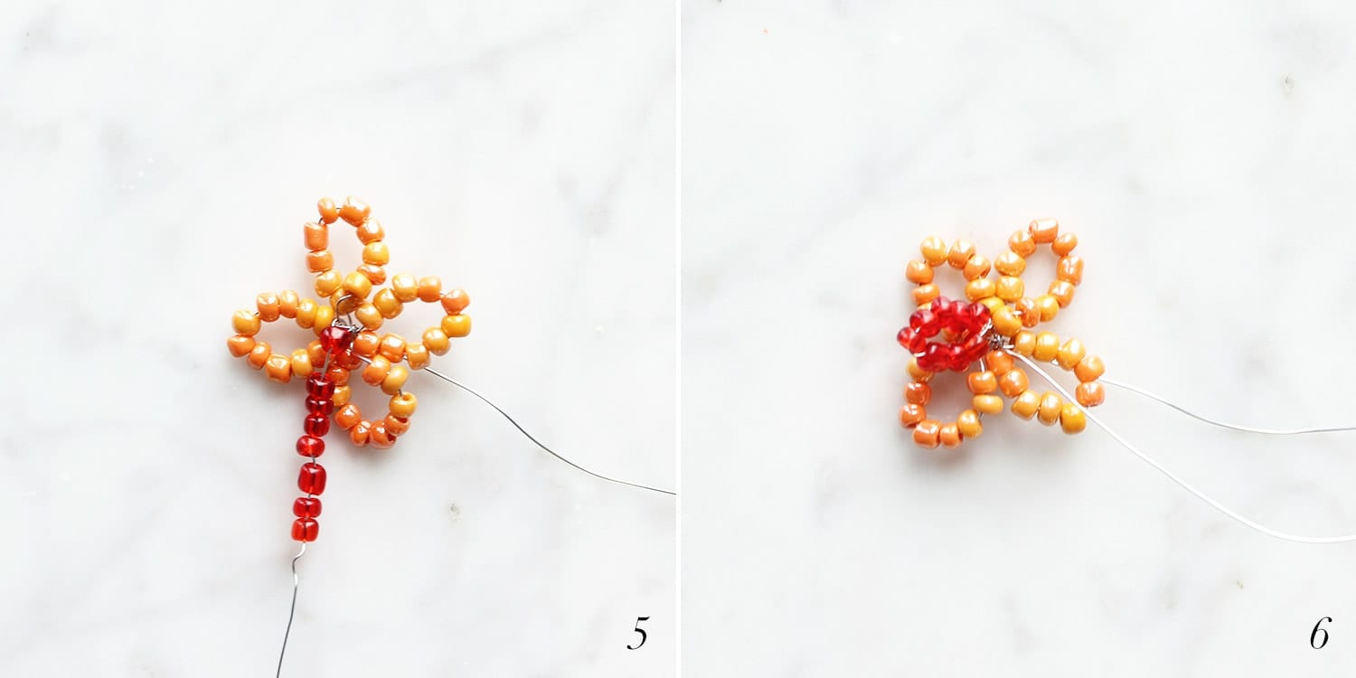 Orange and red beads being strung to create a rounded beaded flower